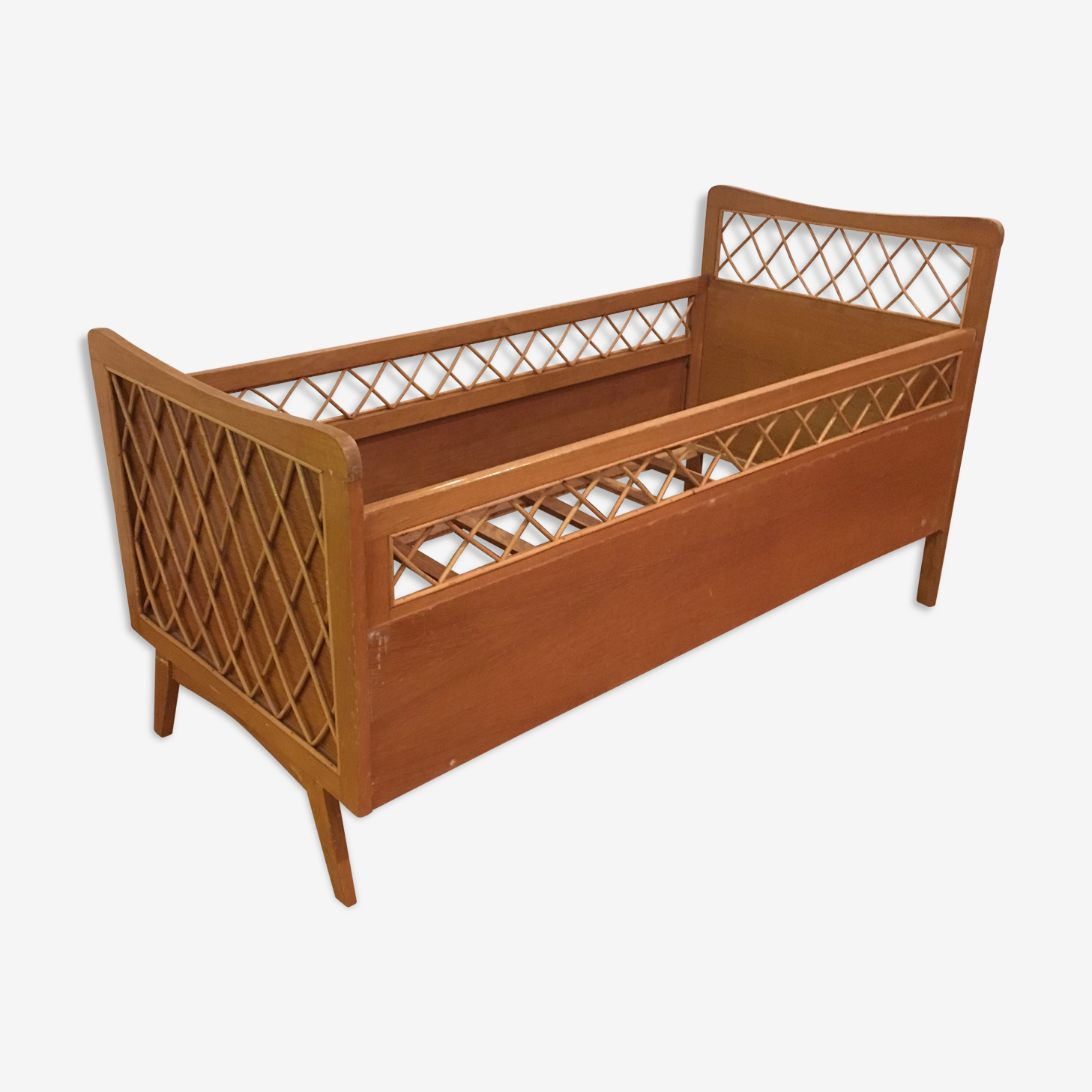 Rattan and wood child bed