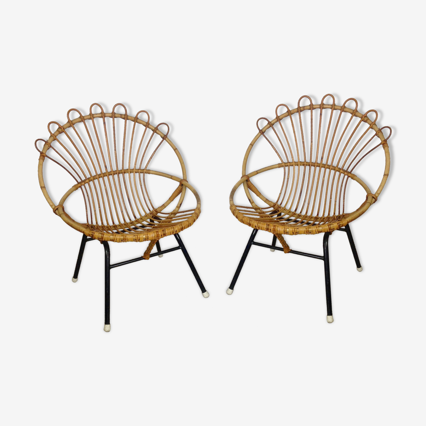 Pair of rattan chairs with black metal of the early 1960s base