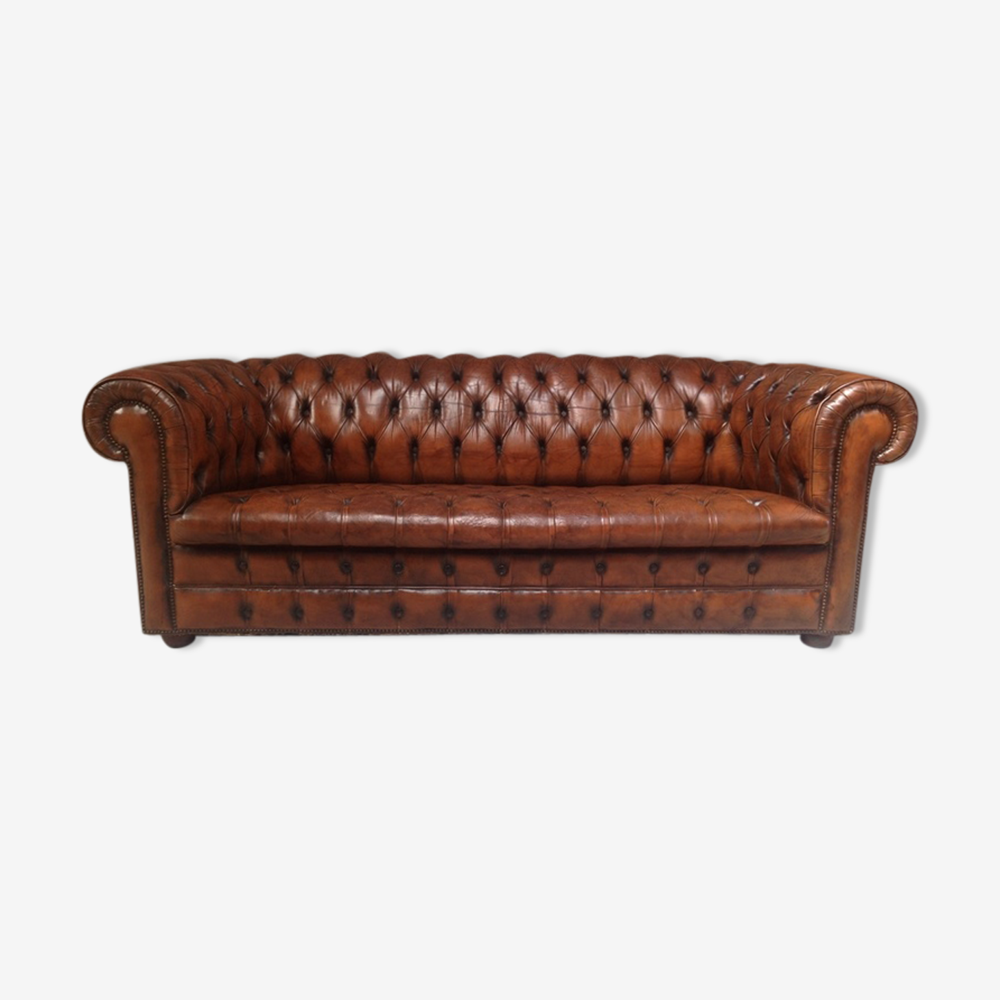 Upholstered chesterfield brown sofa