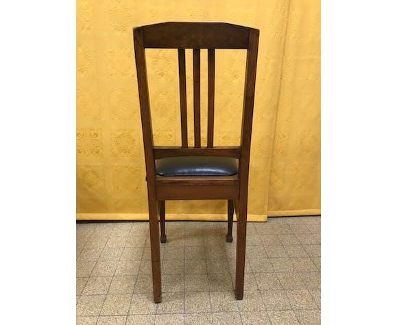 Paire de chaises art deco assise skaï noir
