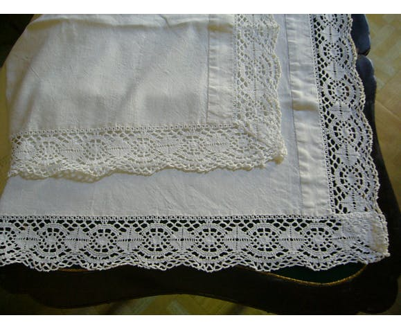 Old cotton sheet with a lace frieze
