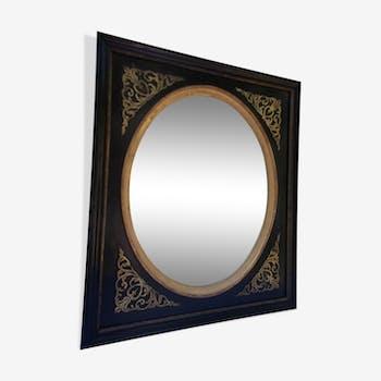 Miroir en médaillon noir et doré 41,5x35cm