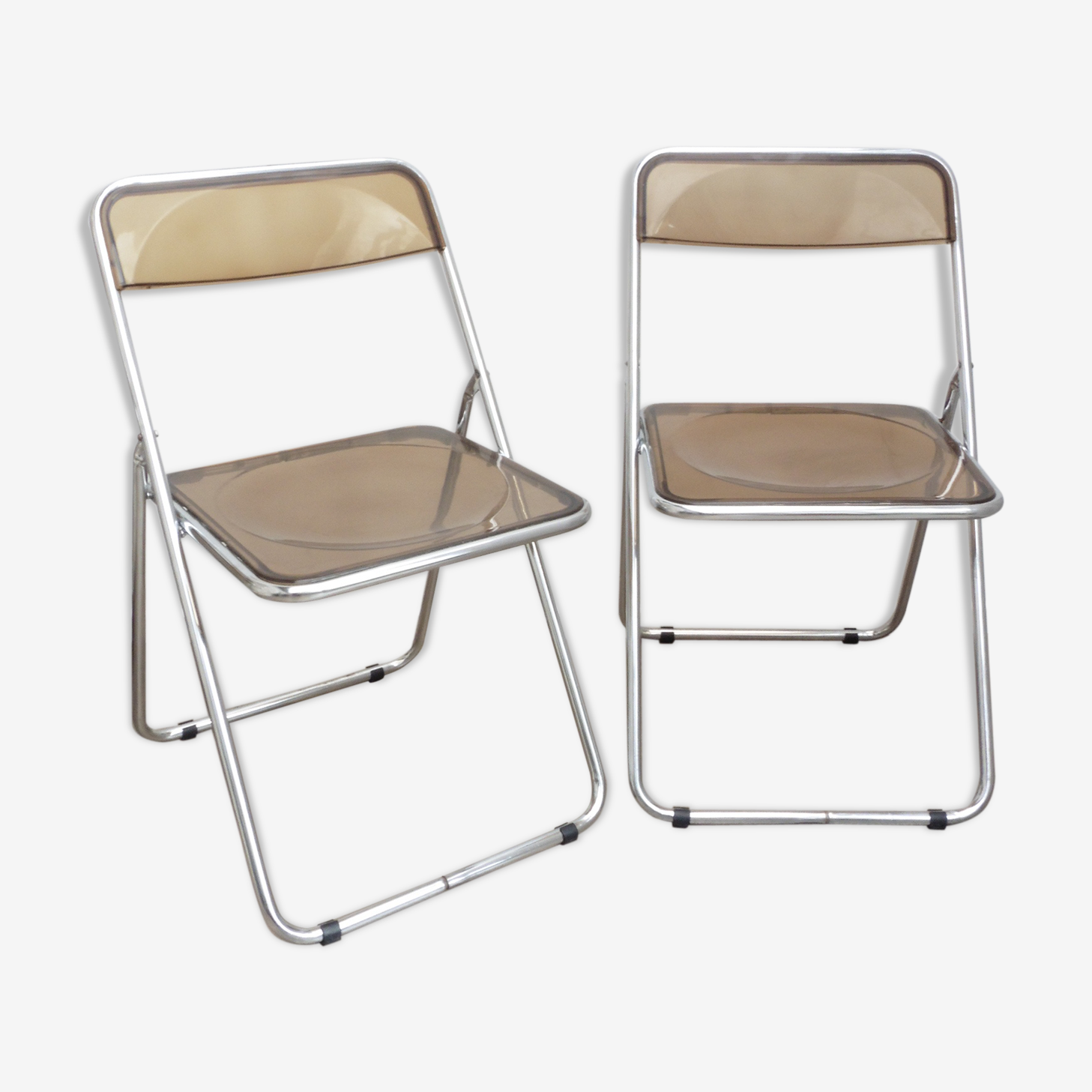 2 chaises pliantes plexiglass fumé