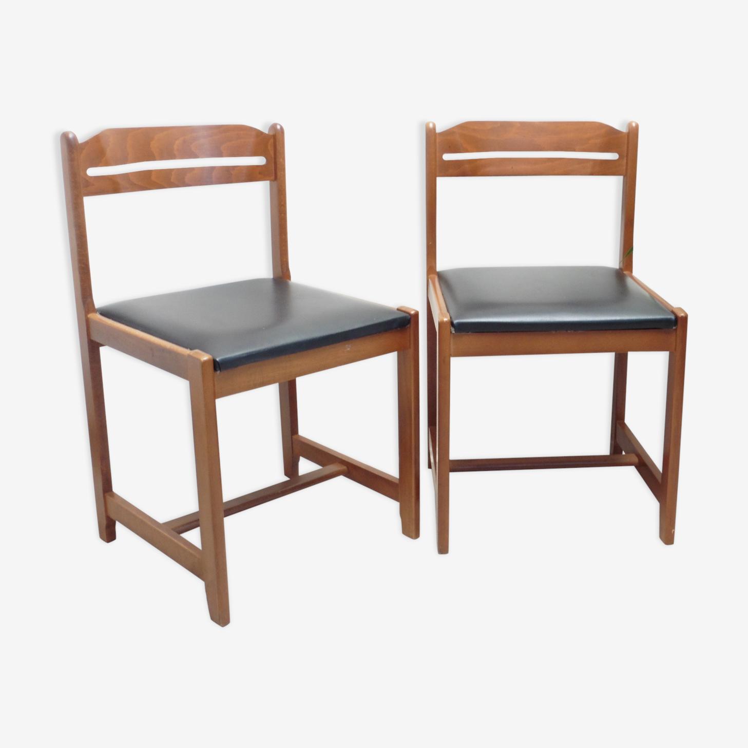 Paire de chaises en bois et skaï noir