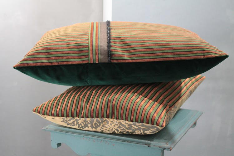 Green and gold cushion in furnishing velvet