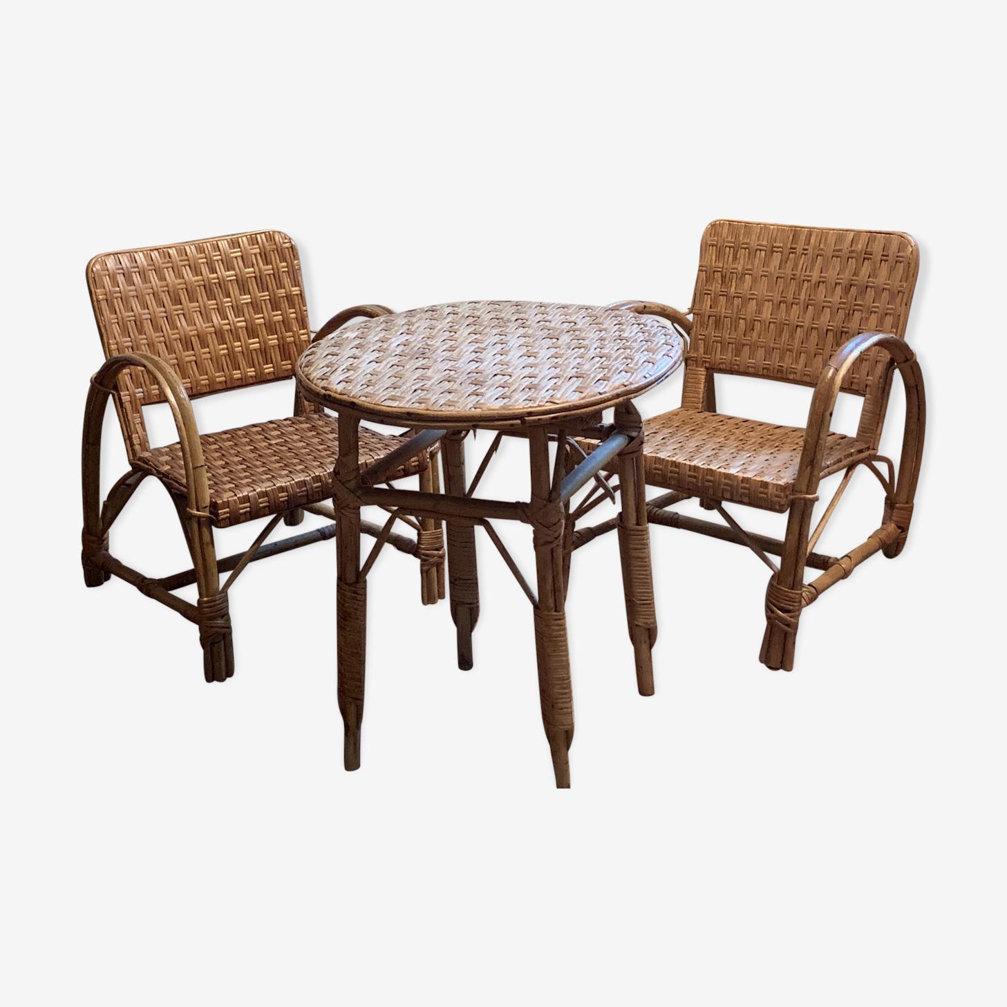 Ensemble de deux fauteuils et table en osier et rotin
