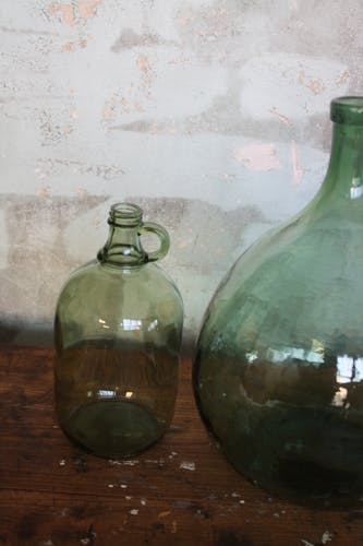 Green demijohn 2 liters with cove