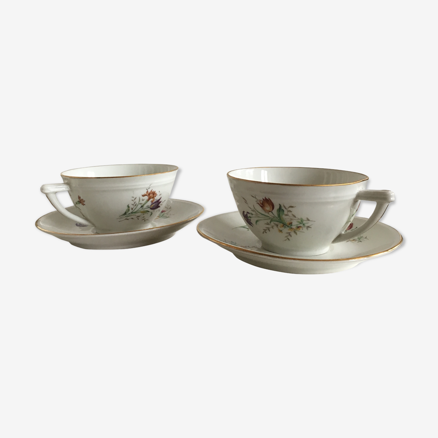 Duo of white Limoges porcelain cups with flowers