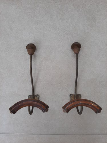 Pair of old wooden and metal wall pads