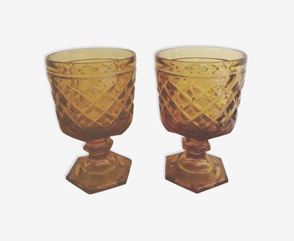 2 vintage amber walking glasses