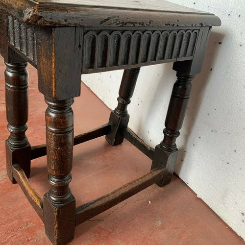 Rustic Renaissance-style stool in solid oak from the 19th century
