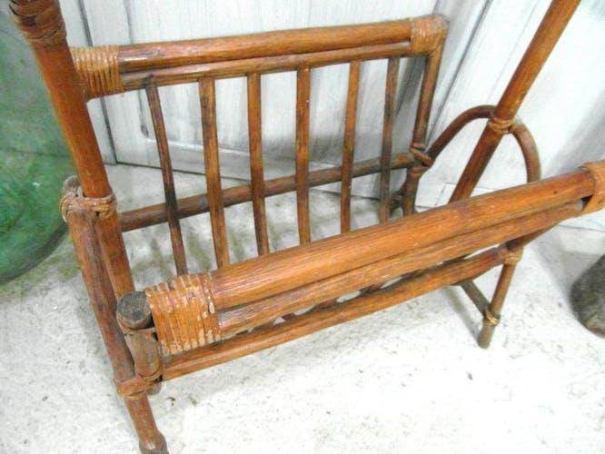 Old rattan magazine rack