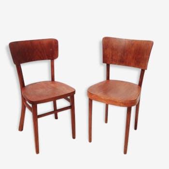 Lot de deux chaises bistrot à marier avec la table assortie.