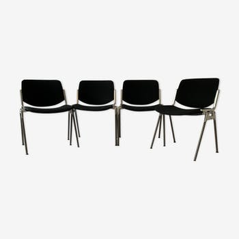 A set of four Castelli DSC 106 chairs, designed by G. Piretti, Italy, 90s