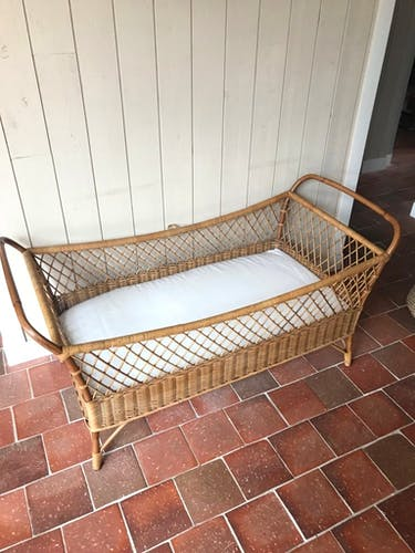 Baby bed in vintage rattan
