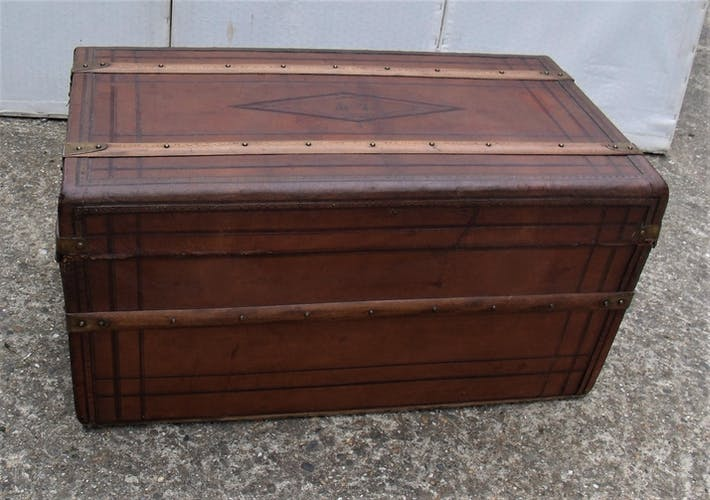 Old wooden trunk covered leather travel chest