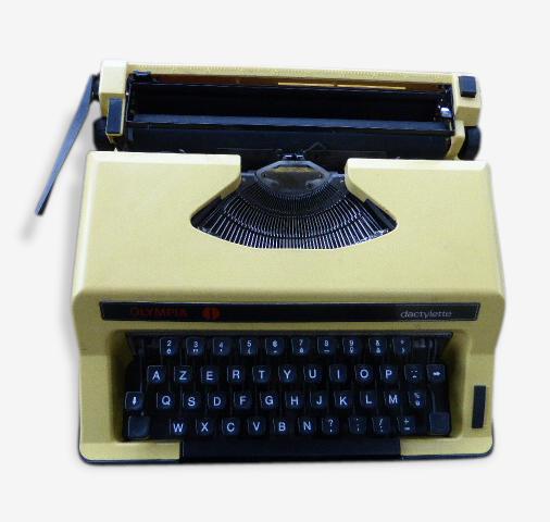 Machine a écrire Dactylette par Olympia, jaune, vintage 1970 et collector