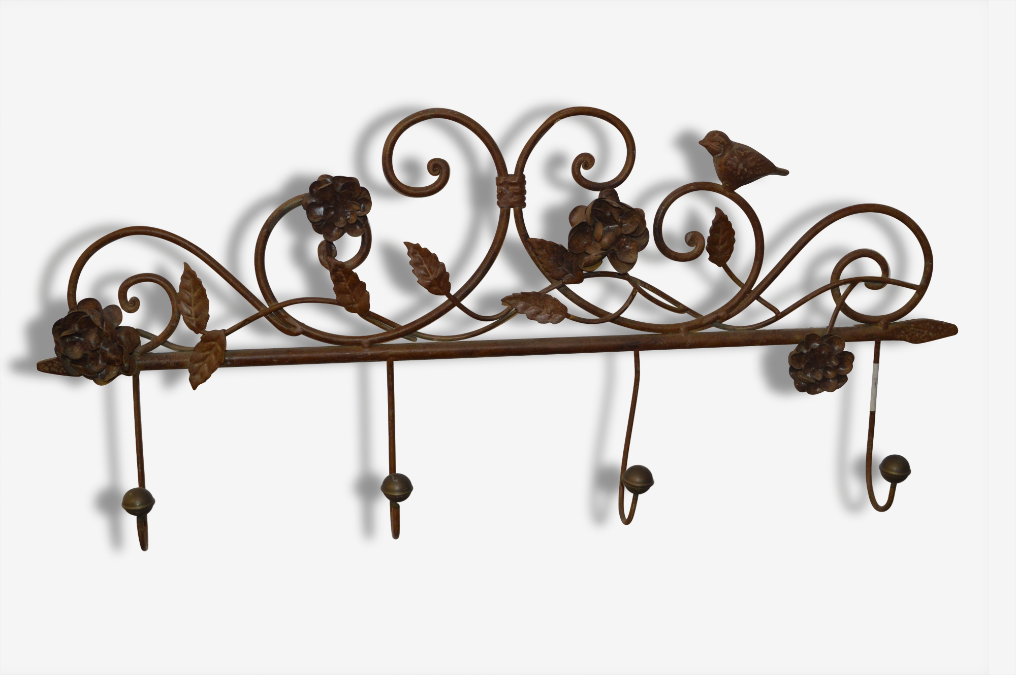 Porte manteaux avec décor de fleurs en fer patiné