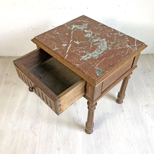 Ancient marble top bedside