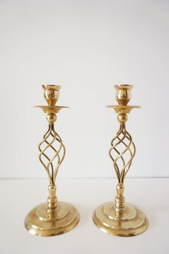 Pair of twisted candlesticks in vintage brass