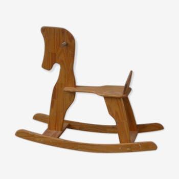 Horse rocking in pine