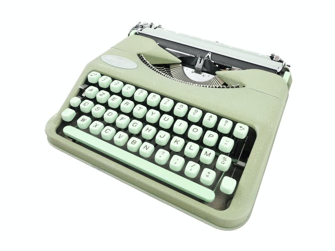 Machine à écrire Hermes Baby vert tilleul révisée ruban neuf