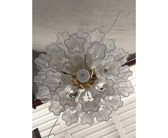"""White glass chandelier with wall """"trunks"""""""