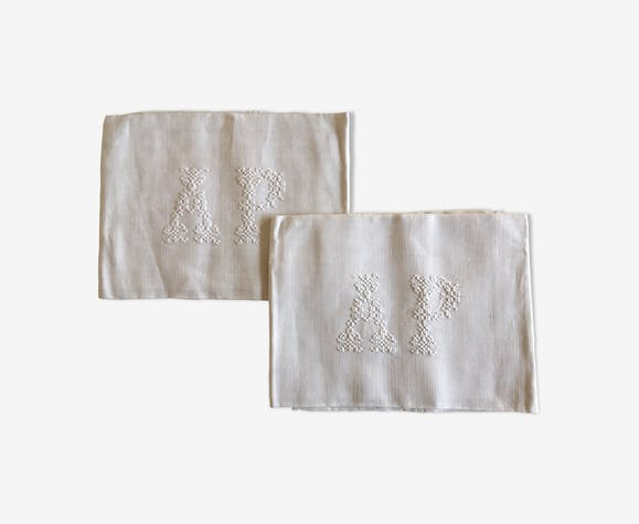 pair of AP monogram towels in cold linen
