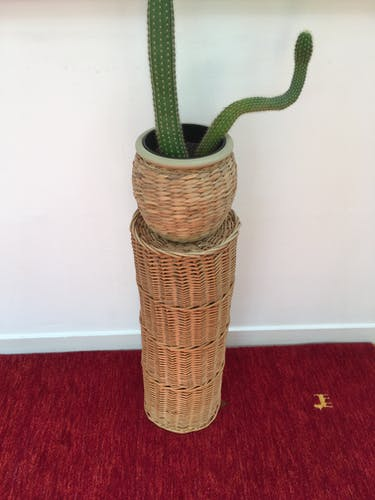 Vintage umbrella holder in wicker rattan