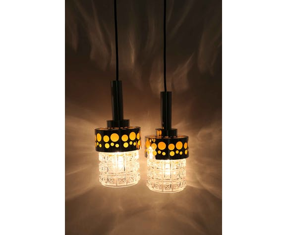 Pair of orange and chrome Raak pendant lights
