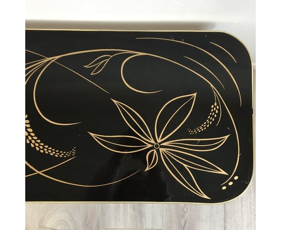 Vintage coffee table with gold motifs