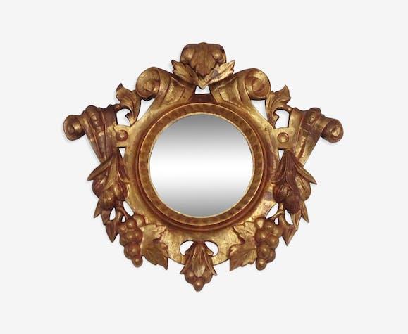 Miroir rond baroque mercure d'argent-bois sculpté doré bois noirci 60x52cm