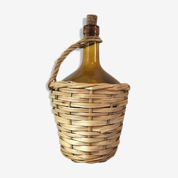 Bottle brown glass covered rattan