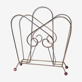 Magazine rack in gold metal