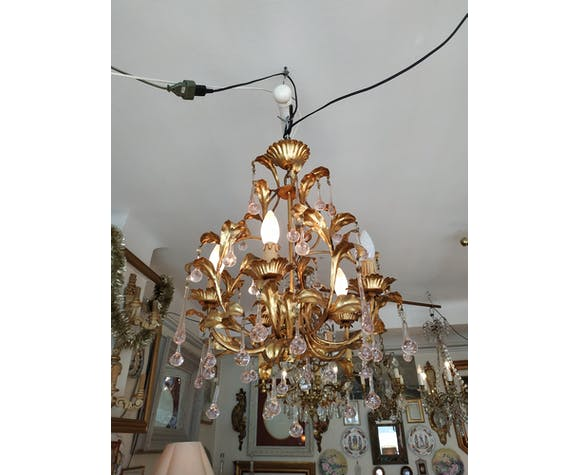 Gold metal chandelier and pink pendants