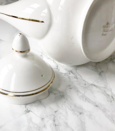 Vintage white porcelain jug decorated with Golden nets