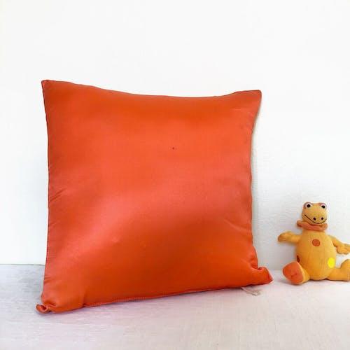 Coussin géométrique 70's orange
