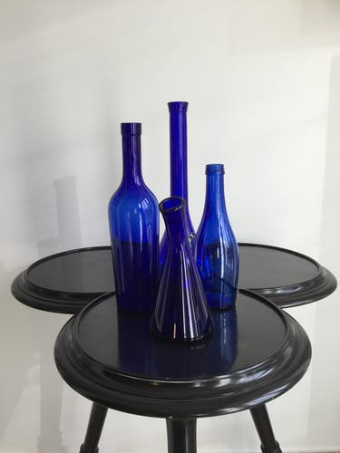Lot of four bottles vials cobalt blue vases