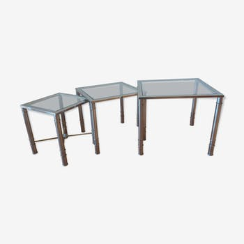 Nesting tables in brass and white glass