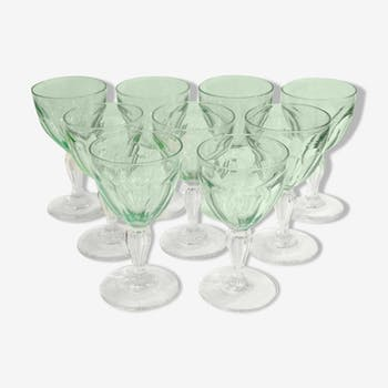Set of nine glasses on foot in cut glass
