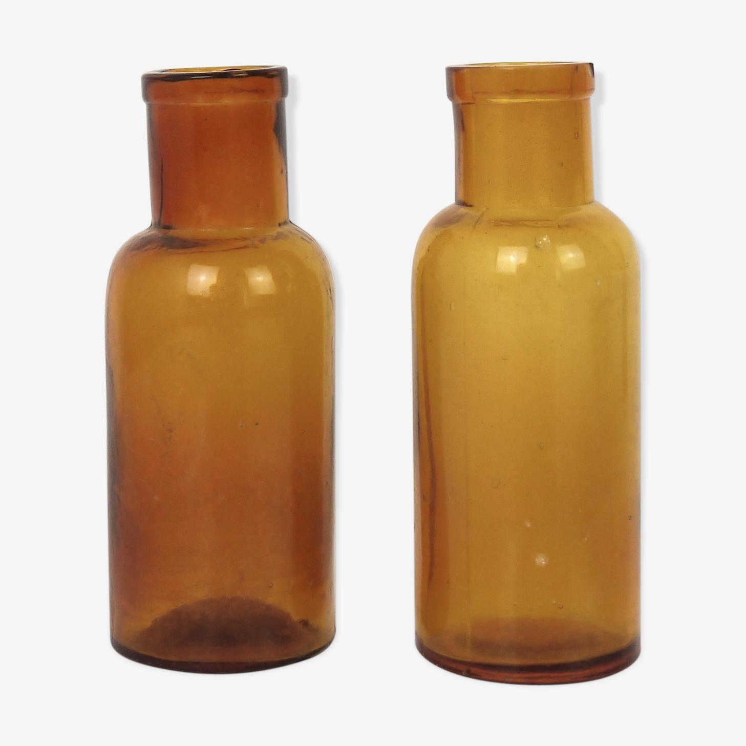 Two brown glass pharmacy bottles
