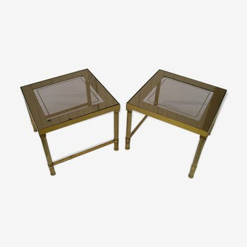 Pair pieces of sofa in gilt bronze and glass mirror of the 1970s