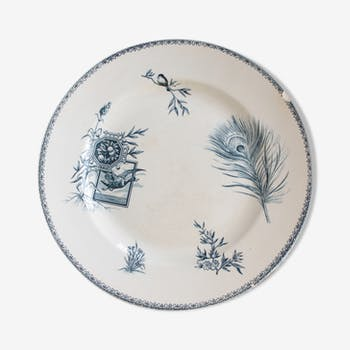 Old dish of opaque porcelain on ground transfer service