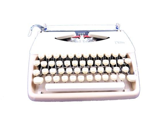 Machine à écrire Triumph Tippa chocolat et caramel révisée ruban neuf