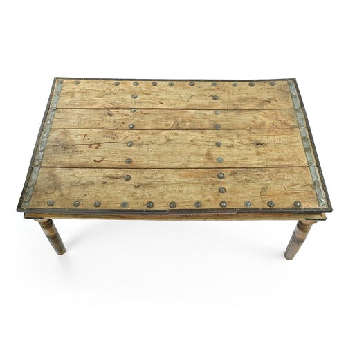 Carved and studded wooden table