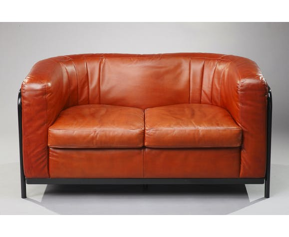 Leather sofa with base in black painted metal, Zanotta model Onda