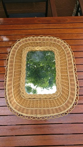 Mirror in wicker and rattan from the 1950s.