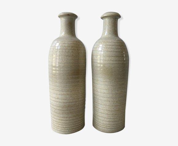 Lot of 2 bottles of sandstone by Jean Dubost, 70s