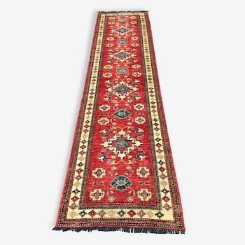 Remarkable oriental rug: former Kazak 310 x 84 cm