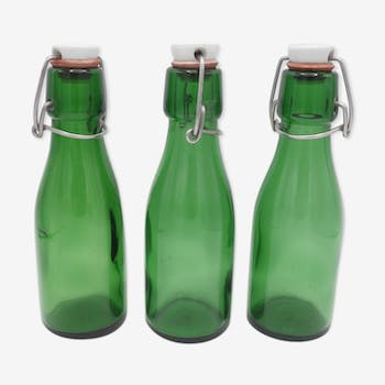 Suite of 3 small bottles